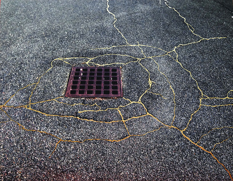 Artist Uses Kintsugi to Mend Cracked Streets with Gold